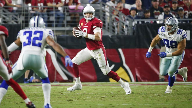 Carson Palmer finished with 325 yards and 2 touchdown passes under intense pressure most of the night.
