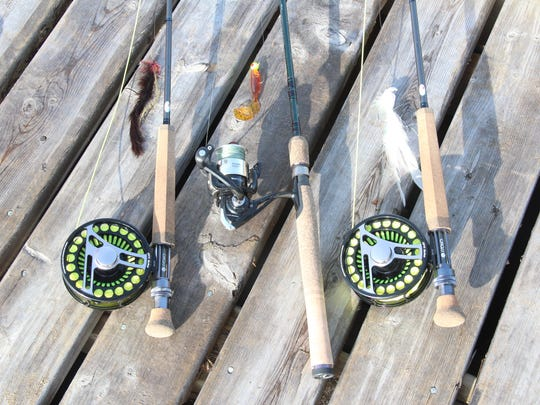 Rods rigged for walleye and northern pike lay ready