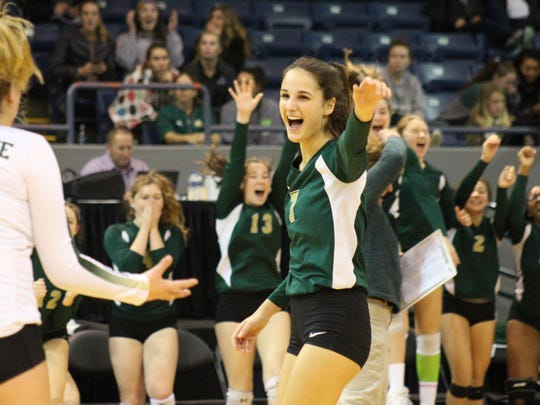 Notre Dame Prep's Natalie Risi celebrates one of her five service aces of the game, in a Class B semifinal at Kellogg Arena, Nov. 17.