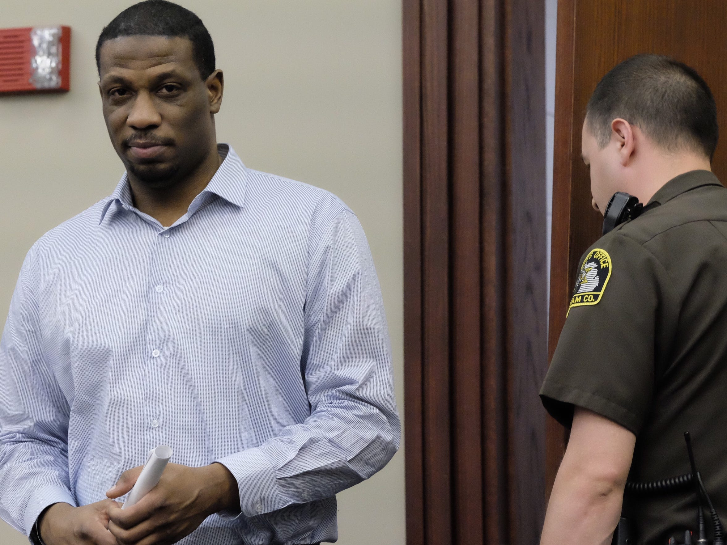 "Robert ""JJ"" Miles enters an Ingham County courtroom"