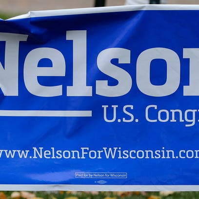 A political yard sign for Democratic candidate for