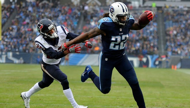 Titans running back Derrick Henry (22)  scores a touchdown in the second half on Sunday, Jan. 1, 2017, at Nissan Stadium in Nashville, Tenn.