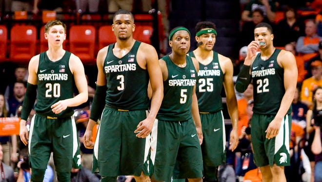 Mar 1, 2017; Champaign, IL, USA; Michigan State Spartans guard Matt McQuaid (20), guard Alvin Ellis III (3), guard Cassius Winston (5), forward Kenny Goins (25) and forward Miles Bridges (22) prepare to defend after a time-out during the second half against the Illinois Fighting Illini at State Farm Center.