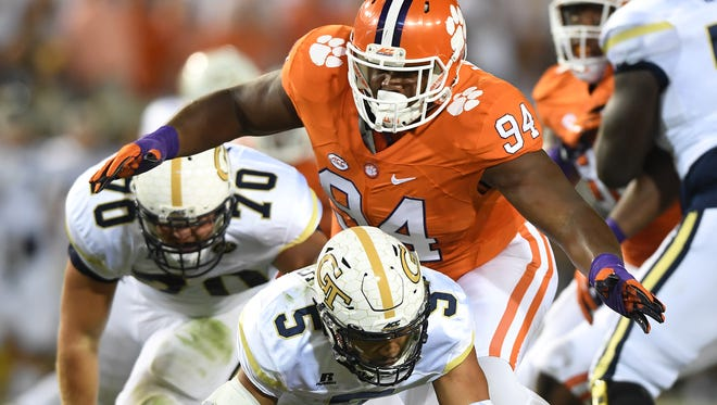 Clemson defensive tackle Carlos Watkins (94) sacks Georgia Tech quarterback Justin Thomas (5) during the 1st quarter at Georgia Tech's Bobby Dodd Stadium.