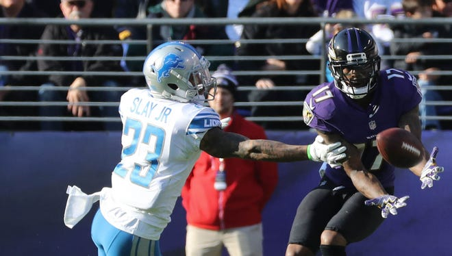Cornerback Darius Slay, left, and the Lions allowed Ravens wide receiver Mike Wallace to catch five passes for 116 yards in Sunday's 44-20 loss.