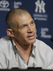 Former New York Yankees manager Joe Girardi answers questions during a baseball news conference in New York.