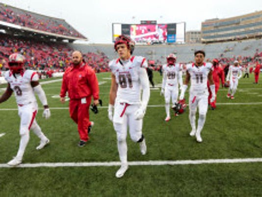 Rutgers players walk off the field after losing to Wisconsin 48-10 in an NCAA college football game, Saturday, Oct. 31, 2015, in Madison, Wis. (AP Photo/Andy Manis)