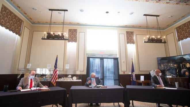 From left, Shawnee County Commissioners Kevin Cook, Bill Riphahn and Aaron Mays conduct business during a commission meeting at the Great Overland Station.