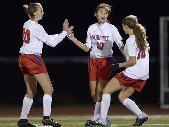 Fairport's Hannah Shin, center, celebrates her goal,