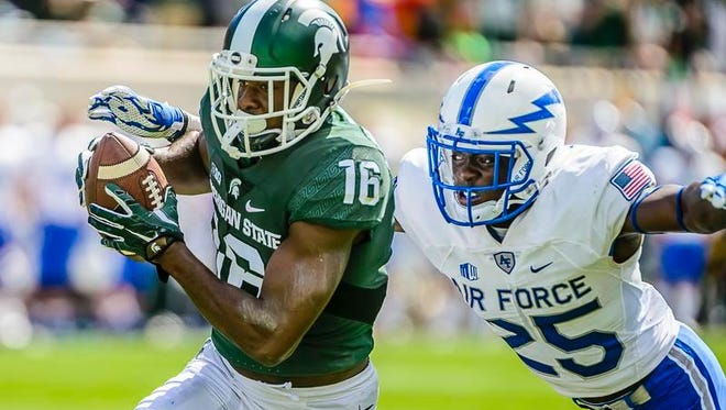 Aaron Burbridge ,16, of MSU heads into the endzone for a touchdown before Roland Ladipo of Air Force can take him down late in the 2nd quarter of their game Saturday September 19, 2015 in East Lansing.