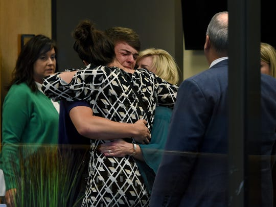 Family members of Emma Walker including her brother, Evan Walker, and mother, Jill Walker, on the right, hug after a jury convicted William Riley Gaul of first-degree murder Tuesday, May 8, 2018. Gaul, a former Maryville College football player, was charged in the 2016 shooting death of his 16-year-old ex-girlfriend Emma Jane Walker.