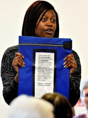 Nikki Suchanic, the director of the county's elections and voter registration office, talks to poll workers about the importance of the official voting machine cartridge bag during a training session Tuesday at the Red Lion Area Senior Center in Red Lion.