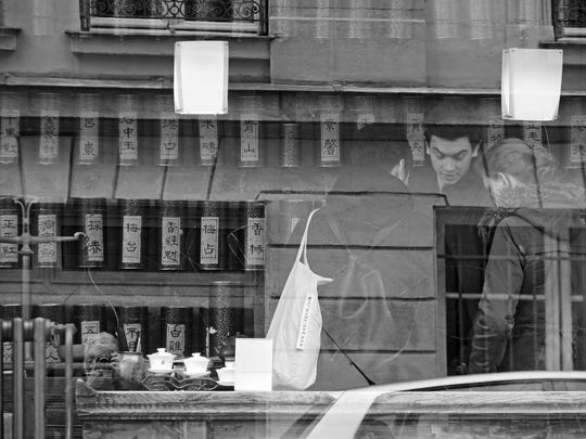"""Tea Shop Reflections,"" photograph by Rolf Olson, part"