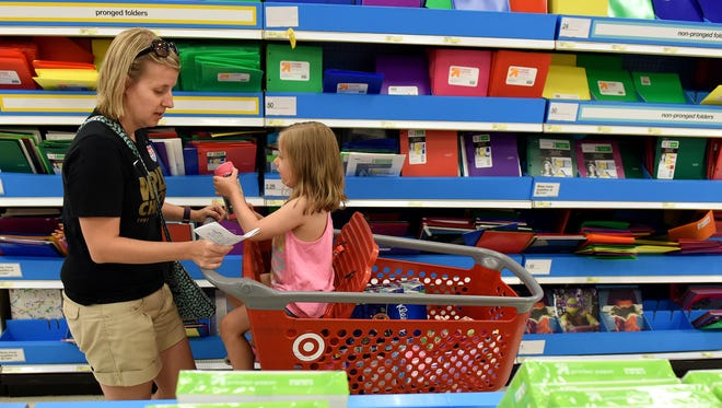 Jennifer Gavlick shops for schools supplies with her daughter  Danielle, 5, at Target on South Louise Avenue. Danielle will be in kindergarten in Brookings this school year.