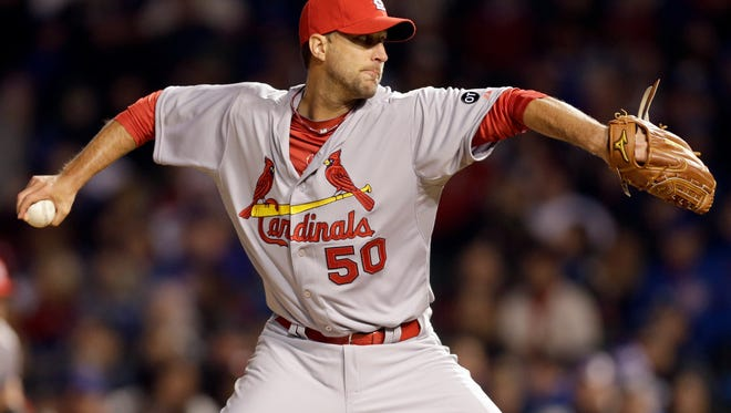 St. Louis Cardinals starter Adam Wainwright throws against the Chicago Cubs during the third inning of a Major League Baseball season-opening game in Chicago, Sunday, April 5, 2015. (AP Photo/Nam Y. Huh)