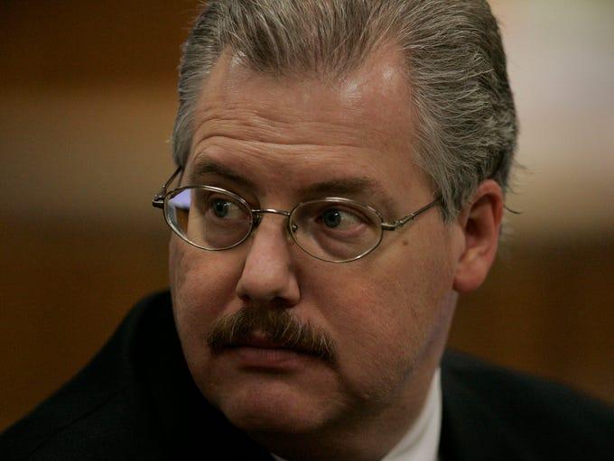 Calumet County District Attorney Ken Kratz sits in