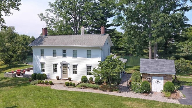 This beautfully restored/updated 1750s Colonial comes with more than 7 acres and a barn for six horses and six cars.