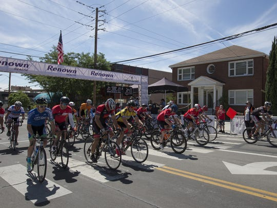Cyclists leave the starting line during the Tour De