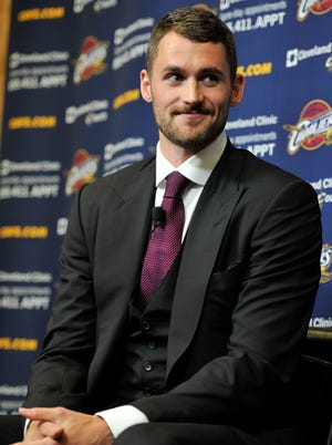 Cleveland Cavaliers player Kevin Love talks to the media at Cleveland Clinic Courts.