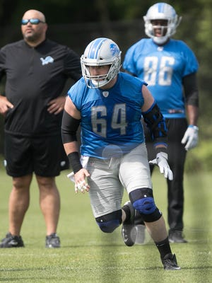 Lions offensive lineman Travis Swanson goes through drills during organized team activities Wednesday, May 31, 2017 at Allen Park.