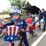 Preston Robertson, 7, participates in the patriotic bicycle parade during the Realities Ride and Rally at Washington Park Saturday, May 23, 2015 in Fort Collins, Co. The Memorial Day event brought the local motorcycle riding community together to raise money for Realities for Children, providing care and resources for children that have been abused.
