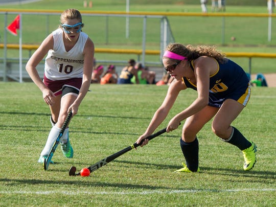 Shippensburg's Kourtney Shoap marks up Greencastle's Jean Hart during a field hockey game at Shippensburg on Tuesday, Sept. 20, 2016. Greencastle defeated Shippensburg 2-1.