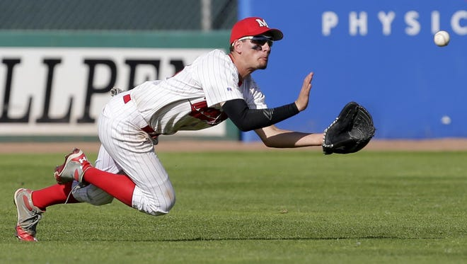 Marathon right fielder Matt Braun dives for the ball during a Division 3 state semifinal matchup with Aquinas during the WIAA state baseball tournament Thursday at Fox Cities Stadium.
