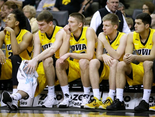 Iowa players, from left, Dom Uhl, Adam Woodbury, Jarrod Uthoff, Brady Ellingson and Andrew Fleming sit on the bech during the second half of an NCAA college basketball game against Wisconsin, Wednesday, Feb. 24, 2016, in Iowa City, Iowa. Wisconsin won 67-59. (AP Photo/Charlie Neibergall)