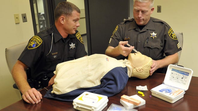 August 4th 2015: The Oakland County Sheriffs Department in Waterford has a kit that will off-set a drug overdose. Its called the Narcan. left to right are Oakland County Sheriff Deputy, Adam Kammer and Sgt. Todd Hill demo the kit on a training dummy. Photo by Charles V. Tines, The Detroit News.