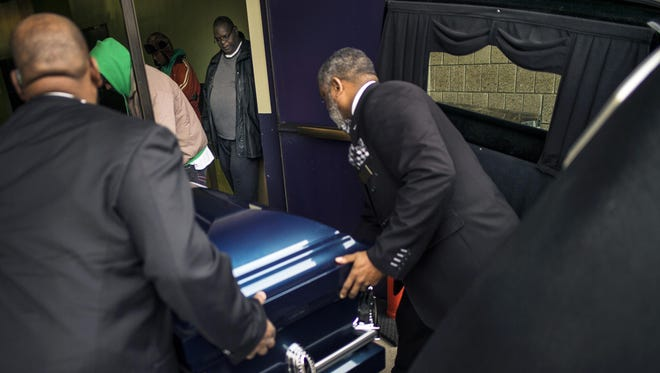 People carry the casket of Jamar Clark, killed in the Nov. 15 shooting by Minneapolis police, during his funeral at Shiloh Temple International Ministries in Minneapolis.