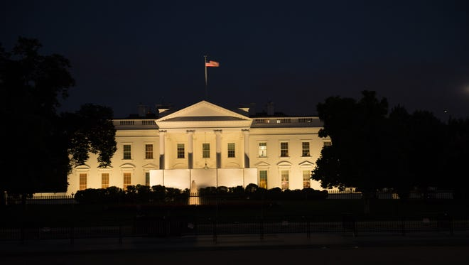 The White House, despite the beautiful chandelier being partially blocked by a partitian, is beautiful at night.