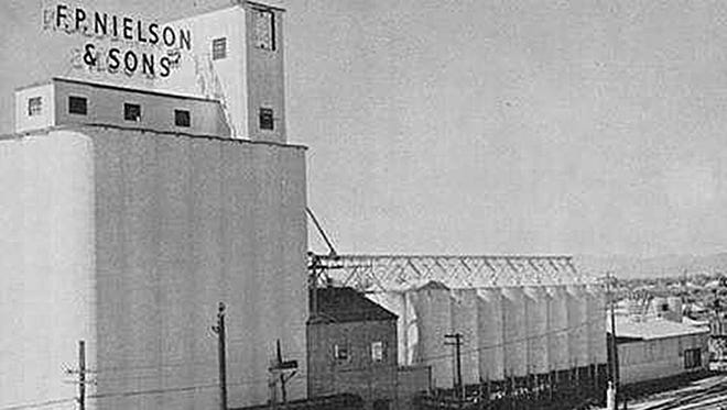 In 1956, the year of this photograph, F.P. Nielson & Sons was a thriving grain business along the railroad tracks and Macdonald. Today, it sits as an idle relic. Some have suggested a rooftop bar and restaurant as an ideal reuse.