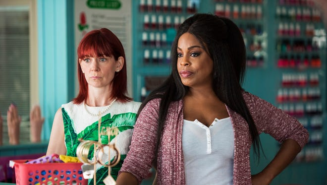 Carrie Preston, left, is Polly and Niecy Nash is Desna in 'Claws.'