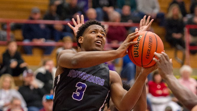 Brownsburg High School junior Cameron Alford (3) drives the ball to the basket as he's defended by Avon High School junior Cedric McBride (33) during the first half of the championship round of the 2018 Hendricks County Boys' Basketball tournament, Saturday, January 6, 2018, at Danville High School.