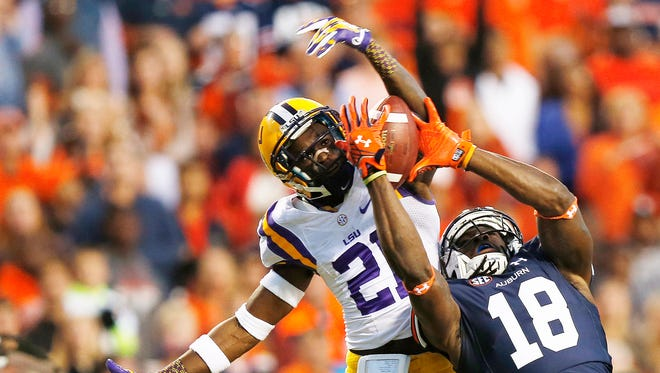 Auburn wide receiver Sammie Coates (18) catches the ball for a touchdown against LSU defensive back Rashard Robinson (21) during the first half of an NCAA college football game.