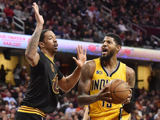 Indiana Pacers forward Paul George (13) drives to the