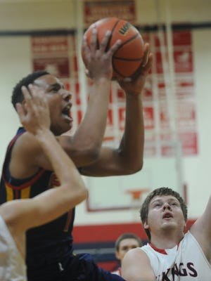 Seton Catholic's Desmond Bane goes for a shot against Blue River during Friday's Class A Sectional 56 semifinal at Blue River High School.