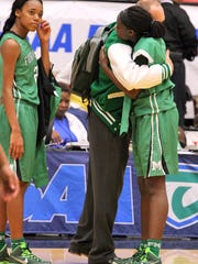 Fort Myers Green Wave head coach Jimmy Roberts consols Larissa Roker and Autumn Giles after their lose to Palm Beach Lakes during the FHSAA Girls 7A Basketball championship at The Lakeland Center Thursday February 19, 2015 in Lakeland, FL. Photos by Cindy Skop, 2015