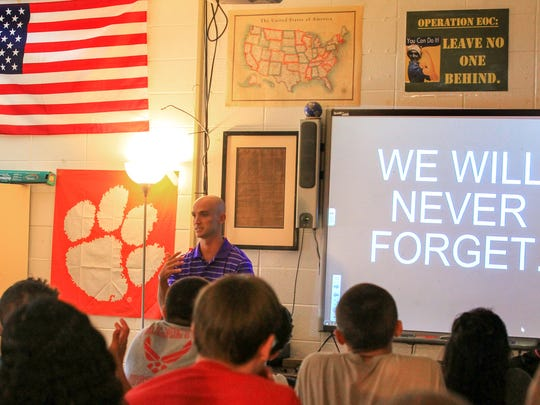 Palmetto High School U.S. History teacher Taylor Hollifield leads a discussion about the events of September 11, 2001 to students who were infants at the time.