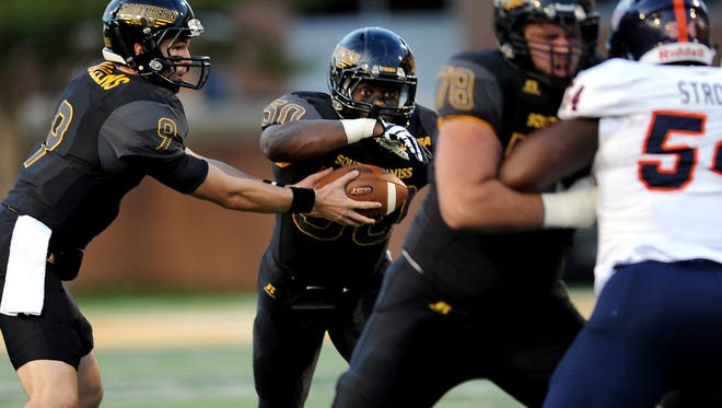 Southern Miss quarterback Nick Mullens  hands off to Jalen Richard  against UTSA on Oct. 17.