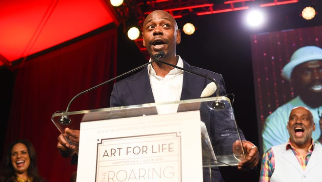 Comedian Dave Chappelle speaks at the RUSH Philanthropic Arts Foundation's Art for Life Benefit at Fairview Farms in Water Mill on Saturday, July 18, 2015, in New York.