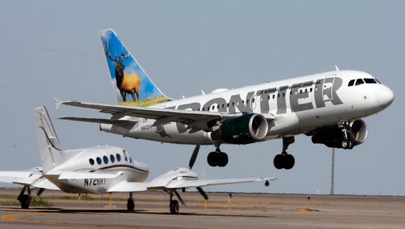 A Frontier Airlines jet lifts off at Denver International