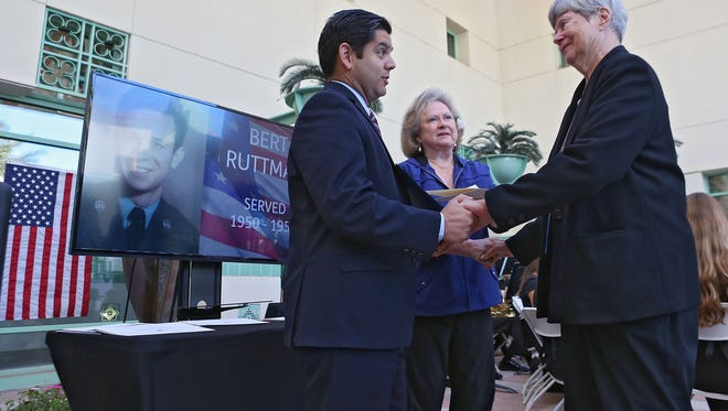 Rep. Raul Ruiz, left, and La Quinta Mayor Pro Tem Kristy Franklin present Kay Ruttman, whose husband Bert Ruttman recently passed away, with a certificate of appreciation during the Veteran's Day Tribute and Recognition Ceremony at La Quinta City Hall, Wednesday, November 11, 201.5