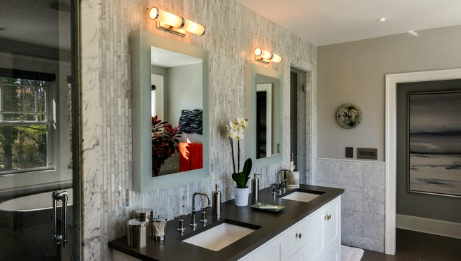 A remodeling project at the McLean, Va., home of Jay Timmons and Rick Olson was supposed to take one year. Instead, it took nearly three years and cost 70 percent more than the original contract price; here, a renovated bathroom. MUST CREDIT: Washington Post photo by Bill O'Leary.