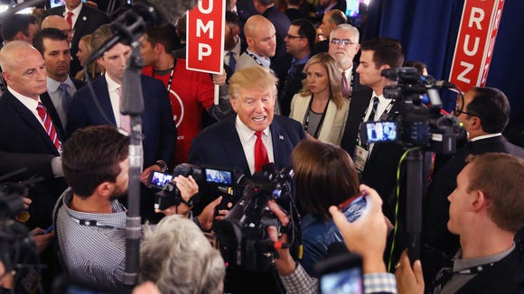 Donald Trump speaks with members of the media in the