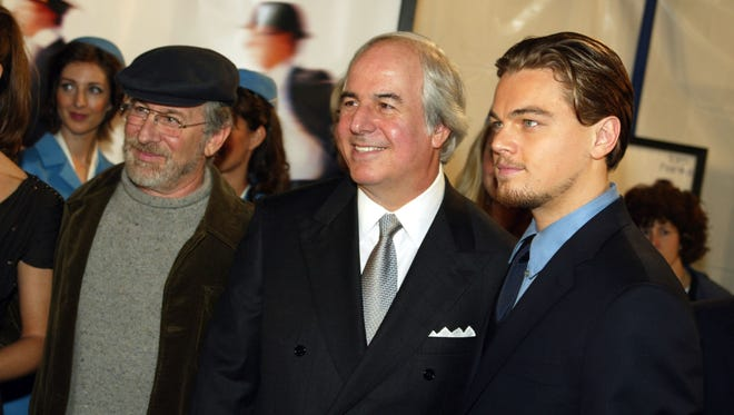 "Steven Spielberg, Frank Abagnale and Leonardo DiCaprio at the premiere of ""Catch Me If You Can"" at the Village Theatre in Westwood, Ca., Dec. 16, 2002."