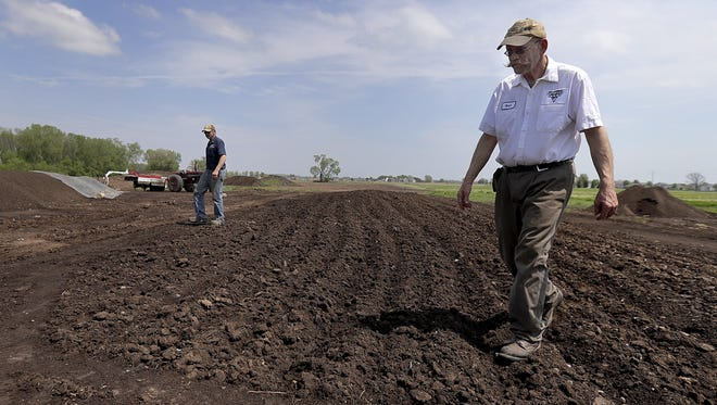 Steve, left, and Mark Peterson at their compost operation on the Petersen Dairy Farm in Grand Chute.