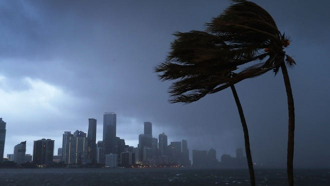The Miami, Fla., skyline is seen as the outer bands of Hurricane Irma hit the city on Saturday evening.
