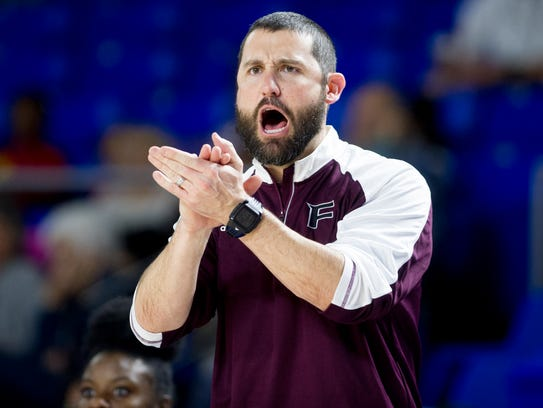 Fulton Head Coach John Fisher calls during Game 1 of