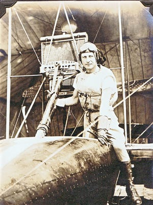 Marine Capt. Francis T. Evans is pictured with an early Curtiss flying boat at Pensacola Naval Air Station.